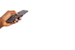 Mans hand holding remote control Stock Photography