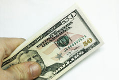 Mans Hand Holding A Stacks Of Paper Dollars Usa On The White Bac Royalty Free Stock Image