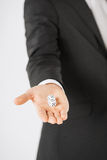 Mans hand holding white casino dice Royalty Free Stock Images