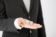Mans hand holding white casino dice Stock Photo