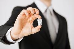 Mans hand holding white casino dice Stock Image
