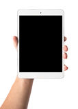Mans hand holding white tablet with blank black screen Stock Photo