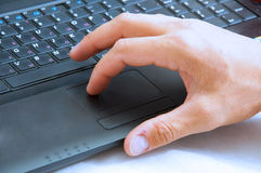 Mans hand on the laptop keyboard Royalty Free Stock Image