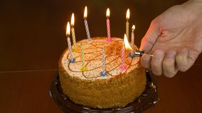 Mans Hand With Lighter Fire Candles On Cake Festive Burning Home