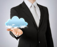 Mans hand showing cloud Royalty Free Stock Photography