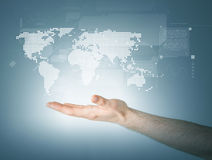 Mans hand showing world map. Connection and future technology concept - closeup of mans hand showing world map royalty free stock photos
