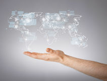 Mans hand showing world map Royalty Free Stock Photo