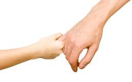 Mans hand som rymmer ett barns hand Fotografering för Bildbyråer