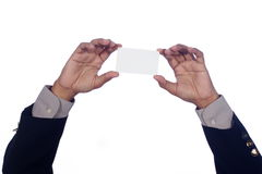 Mans hand som rymmer ett tomt kort Arkivfoto