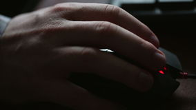 Mans hand using a computer mouse. Close up stock video