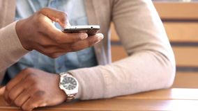 Mans hand using smartphone. In bar stock footage