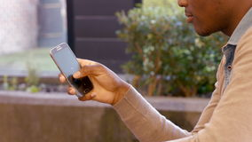 Mans hand using smartphone. Side view of mans hand using smartphone stock footage