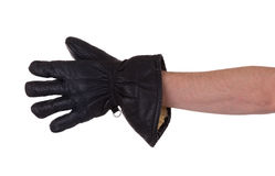 Mans hand in very old black leather glove Royalty Free Stock Photos