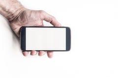 Mans handinnehav och använda den smarta telefonmodellen för mobil Royaltyfria Foton