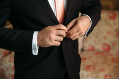 Mans hands with cufflinks and clocks. Elegant gentleman clother. Concept of business dress Royalty Free Stock Photos