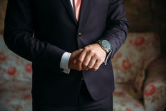 Mans hands with cufflinks and clocks. Elegant gentleman clother. Concept of business dress Royalty Free Stock Photography