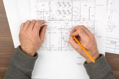 Mans hands drawing drafts, top view Royalty Free Stock Photography
