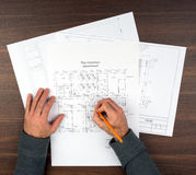 Mans hands drawing drafts Royalty Free Stock Image