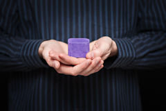 Mans hands holding jewlery box. Shallow depth of field royalty free stock image