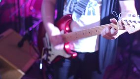 Mans hands playing electro guitar on wedding party.