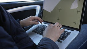 Mans hands using laptop with screen template. stock video footage