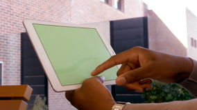 Mans hands using tablet. Side view of mans hands using tablet stock video footage
