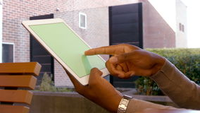 Mans hands using tablet. Side view of mans hands using tablet stock footage