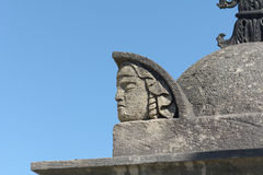 Mans head statue carved into tomb Stock Image