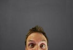 Mans huvudet i framdel av den svart tavlan Fotografering för Bildbyråer