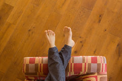 Mans legs on the couch Royalty Free Stock Images