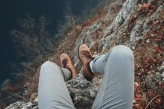 Mans legs on hil of mountain Royalty Free Stock Photography