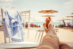 Mans legs stretch out in a lounge bar Royalty Free Stock Photos