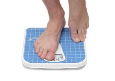 Mans legs ,weighed on floor scale. Royalty Free Stock Image
