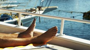 Mans legs on yacht stock photography