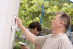 Mans make renovation outdoor Stock Image