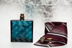 Mans perfume with tie and cuff Royalty Free Stock Photo