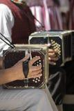 Mans playing the bandoneon Stock Photos