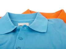 Polo shirts. Mans polo shirts - blue and orange colors Stock Photo
