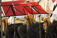 Mans with saxophones. Sit behind the music-stand Stock Images