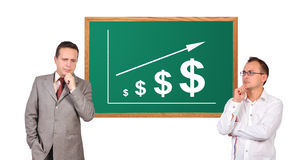 Mans and scheme profits dollar. Two businessman and scheme profits dollar  on desk Royalty Free Stock Photography