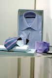 Mans shirts and necktie. In shop window royalty free stock image