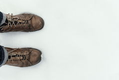 Mans shoe ond the snow, legs view Royalty Free Stock Photos