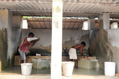 Mans washing laundry at Fort Cochin on India Stock Images