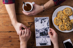 Mans and womans hands. Black-and-white photo. Couple. Tea and cookies. Stock Photography