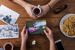 Mans and womans hands. Black-and-white photos. Couple. Tea, cookies, phone. Royalty Free Stock Image