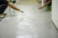 Mans work epoxy floor Stock Photos