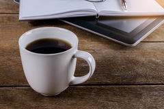 Mans working place at wooden desktop with coffee Stock Photography