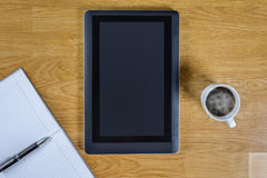 Mans working place at wooden desktop with coffee Royalty Free Stock Photography