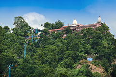 Mansa Devi Temple. Hindu temple of goddess Mansa Devi is located on top of the Bilwa Parvat on the Sivalik Hills, the southernmost mountain chain of the Stock Photos