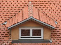 Mansard. Tiled roof's mansard with two windows Stock Image